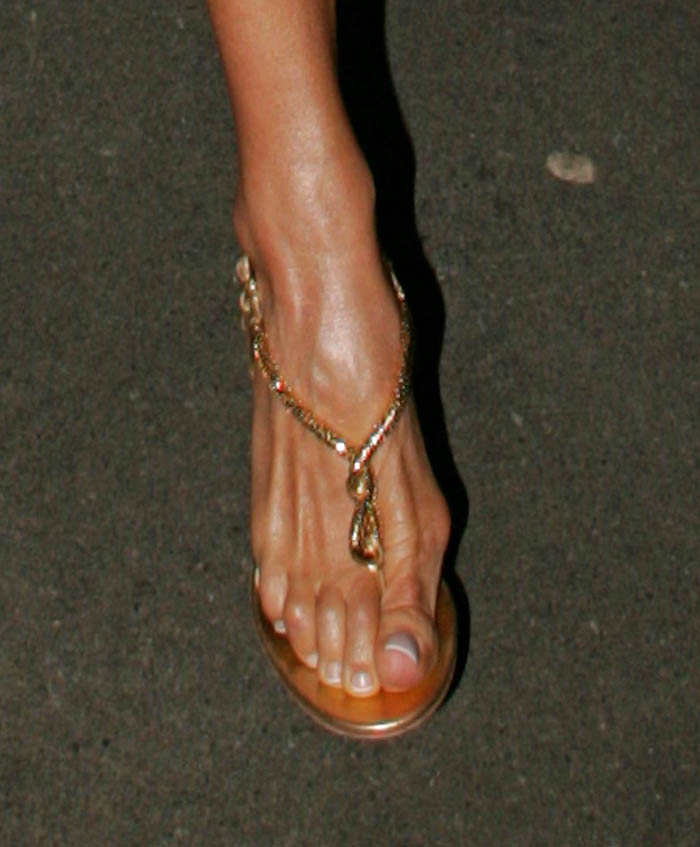 ... Beckham needs her twisted club feet fixed cuz of her ridiculous shoes
