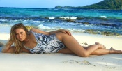 "***NORTH AMERICA usage for the promotion of the 2016 Swimsuit Issue only, ending March 14, 2016; credit: Frederic Pinet/Sports Illustrated; caption must include the words ""on sale now."" NO INTERNATIONAL PRINT USE.*** Swimsuit: 2016 Issue: Portrait of Ronda Rousey wearing body paint during photo shoot. Petit St. Vincent, The Grenadines 1/5/2016 CREDIT: Frederic Pinet/Sports Illustrated"