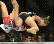 Champion Ronda Rousey, red, battles Miesha Tate, blue, during their Women's Bantamweight Championship bout during UFC 168 at the MGM Grand Garden Arena in Las Vegas Saturday, December 28, 2013. Rousey beat Tate via round three arm bar. (Photo by Hans Gutknecht/Los Angeles Daily News